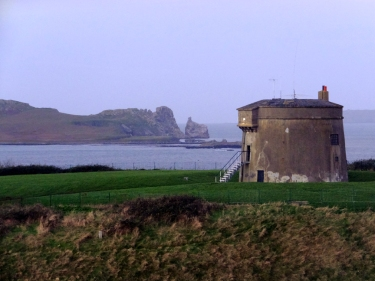 One of Ireland's many Martello Towers still watches over the entrance to the harbor, a relic of the Napoleonic wars. In the background is the island known as Ireland's Eye.