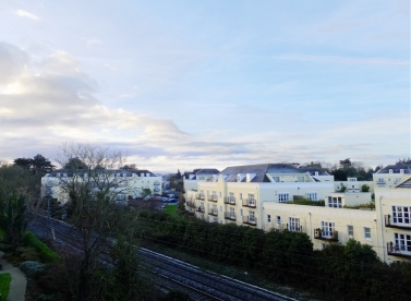 In this view from our Portmarnock apartment, you can see the tracks of the commuter train that frequently took us to Dublin city.